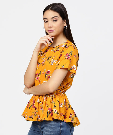 Yellow printed short sleeve with a gathered peplum style top