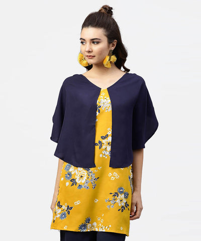 Yellow printed tunic with attached cape sleeves and V-neck