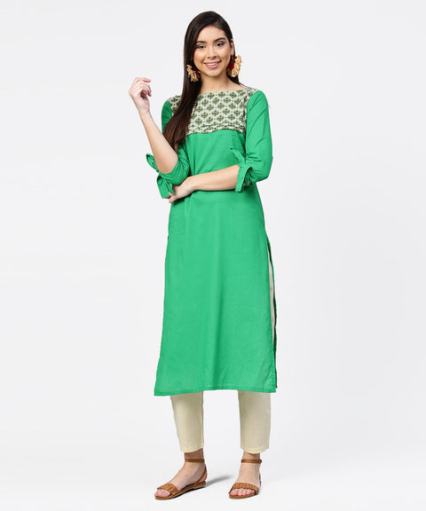 Green yoke printed half sleeve cotton kurta with cream ankle length pallazo