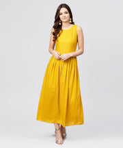 Bright Yellow rayon A-line box pleated Maxi with attached Jacket till Yoke and emblished with tassels