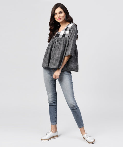 Grey top with V-neck and flared sleeves