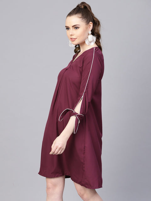 Burgundy A-line dress with knot style sleeves