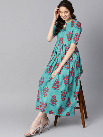 Turqish blue color printed half sleeve pleated maxi dress with deep back and tassel detailing.