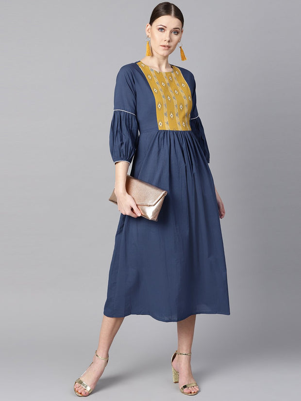 Solid Blue dress with Front Printed yoke & pleated sleeves