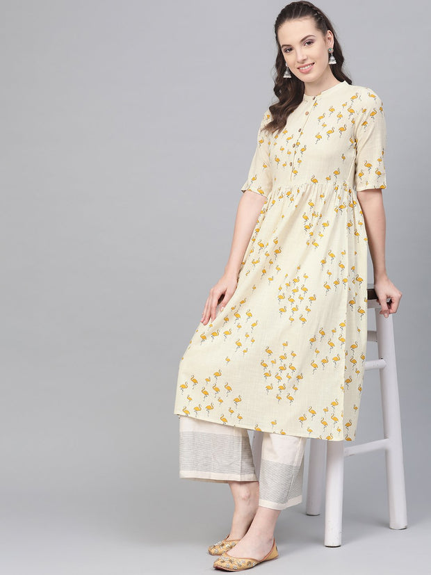 Off white and yellow ochre flamingo printed dress with a detachable belt detailing on the yoke