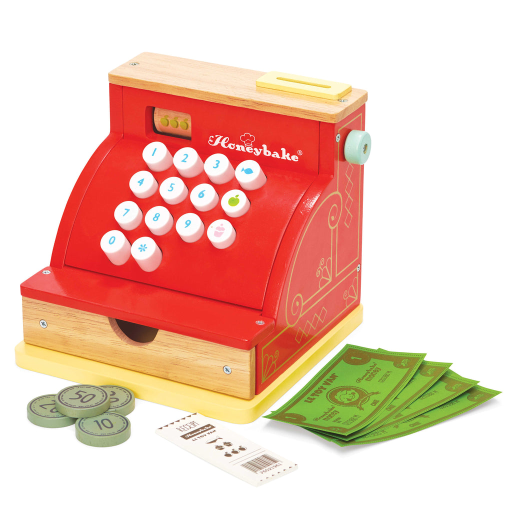 Wooden toy red and gold vintage cash register with money, notes and receipt