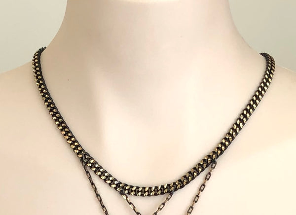 RED JADE IN BLACK CHAIN NECKLACE