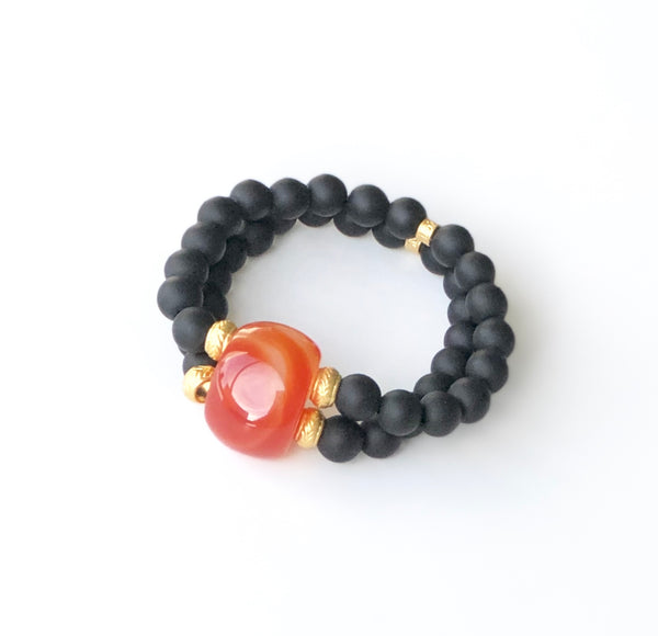 BLACK AND ORANGE BRACELET