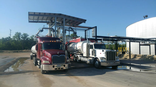 Red and white Gardner Asphalt Tanker Trucks