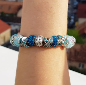 Blue Crystal Charm Bracelet on a girl's wrist
