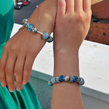 two girls each wearing a Blue Crystal Charm Bracelet
