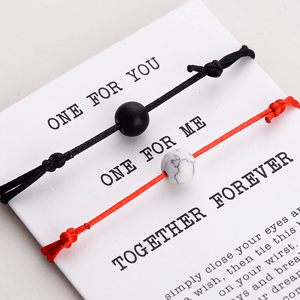 Gift card with red string and black string natural stone pair of bracelets