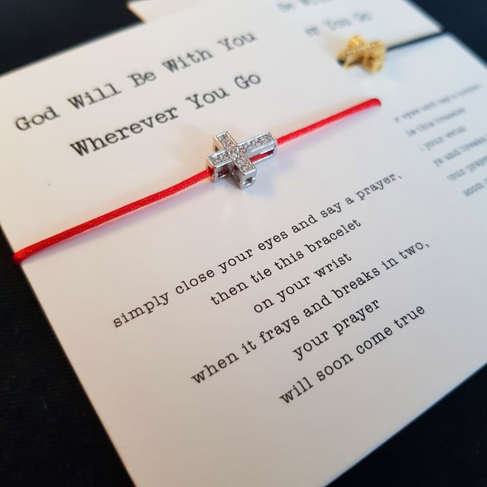 red string cross bracelet card