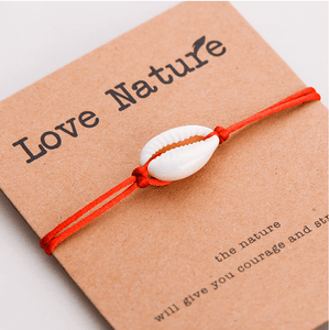 Natural shell red string bracelet on a gift card