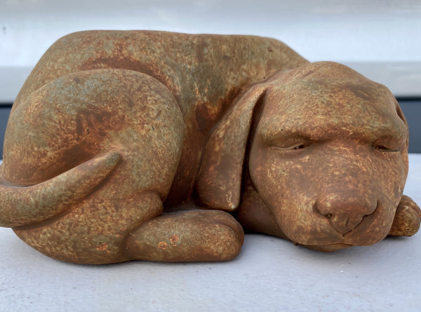 CONCRETE PLANTER, SLEEPING DOG (RUST)