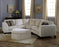 Juno - example living room w/ Left Arm Sofa W/ Return, Right Arm Loveseat and Ottoman