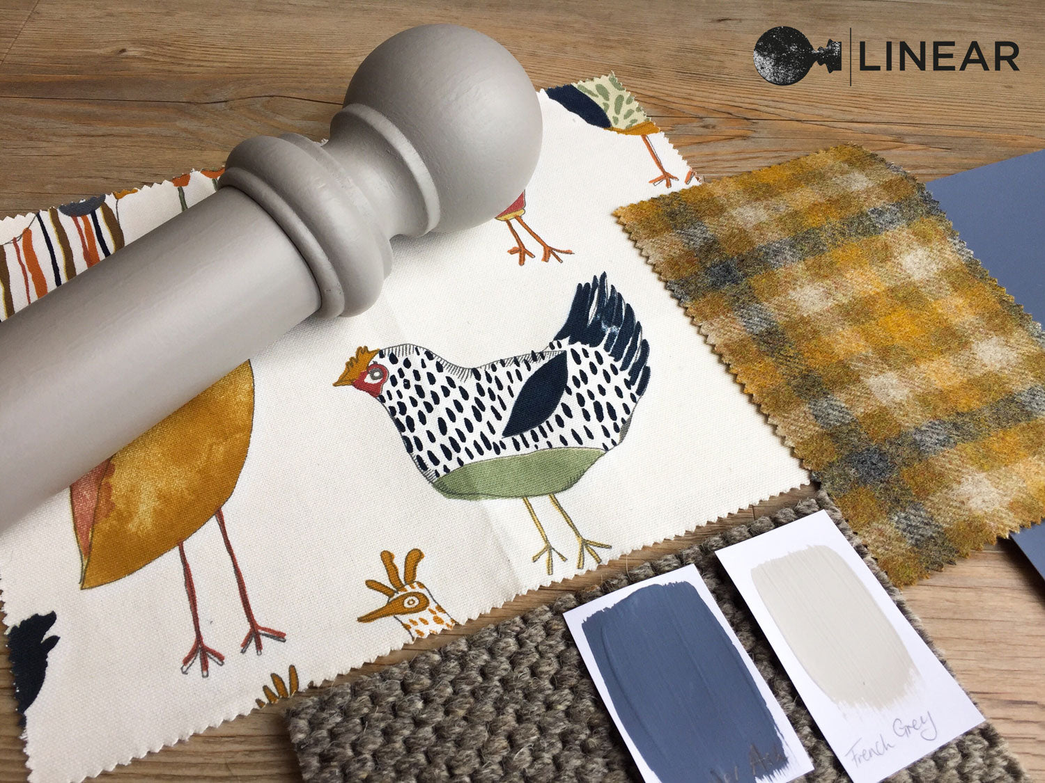 grey and mustard interior design scheme with fabrics paints and flooring