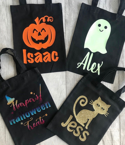 Gorgeous halloween bags, perfect to take trick or treating with to collect lots of sweets and chocolates. We have pumpkin designs, cat designs, witch designs and ghost designs that glow in the dark. All personalised for your little one.