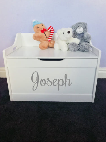 The pristine white wooden toy box. Makes a fabulous present for your little ones nursery or a friends baby nursery. Perfect yet simple colours that fit an interior of everybody's house. Can be personalised for a baby girl or baby boy.  Our personalised children's furniture is of the highest quality you could possibly find. We make sure it is unique, special, spacious and fits any style of interior to go with your house.