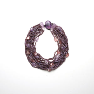 Necklace in amethyst and glass pearls