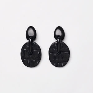 Earrings in ebony and crocodile leather