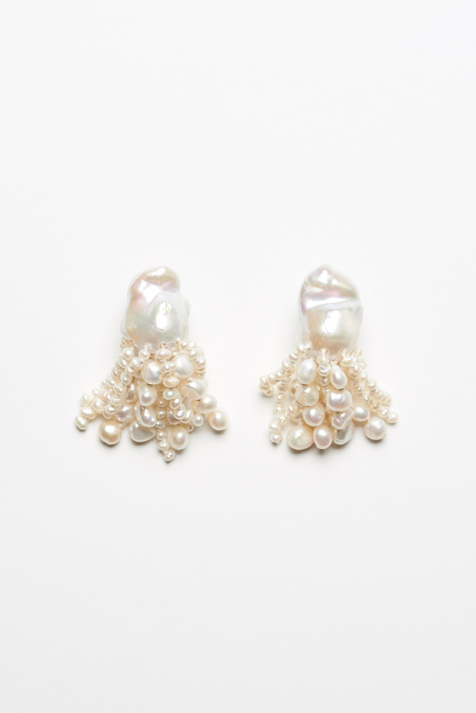 Earclips in baroque and fresh water pearls