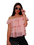 A chiffon pink-peach top with an off-the-shoulder neckline, ruffled short sleeves and billowy silhouette. Ideal for bright and sunny days or even a romantic evening.