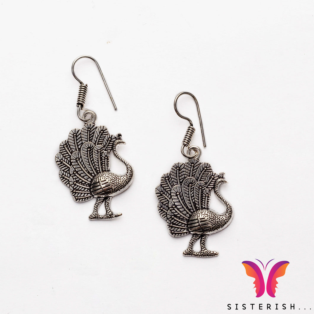 Beautiful lightweight Peacock shaped german silver earrings