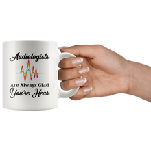 Load image into Gallery viewer, Audiologist Coffee Mug Funny Pun Gift Glad You're Hear - Hundredth Monkey Tees