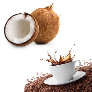 coconuts and coffee splashing in a mug on coffee beans