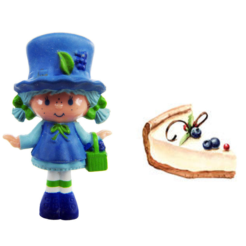 Blueberry shortcake character and slice of blueberry cheesecake