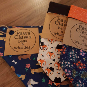 Bandanas in recycled paper packing by paws claws bells and whistles