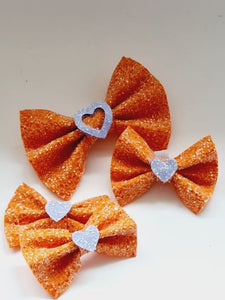 The Glitter Bow Hair Clip - various