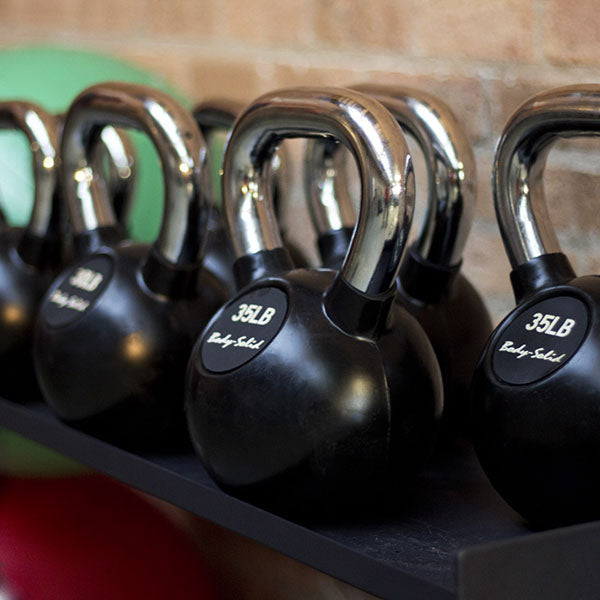 Body Solid - Chrome Handle, Rubberized Kettle Bell Set 5-50 Singles - ENVIOUS BODY