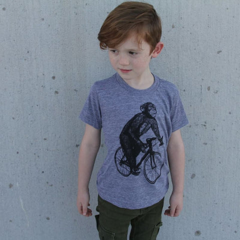 Chimpanzee on a Bicycle Kids T-Shirt