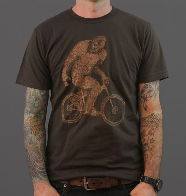 Sasquatch on a Mountain Bike Mens T-Shirt - Brown / XS - Unisex Tees