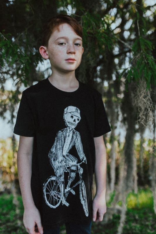 Skeleton on a Bicycle Kids T-Shirt - 2 / Solid Black Tri-Blend