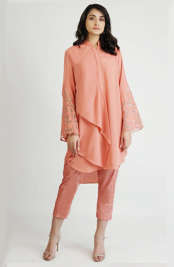 Pink tunic with applique cutwork sleeves (one piece)