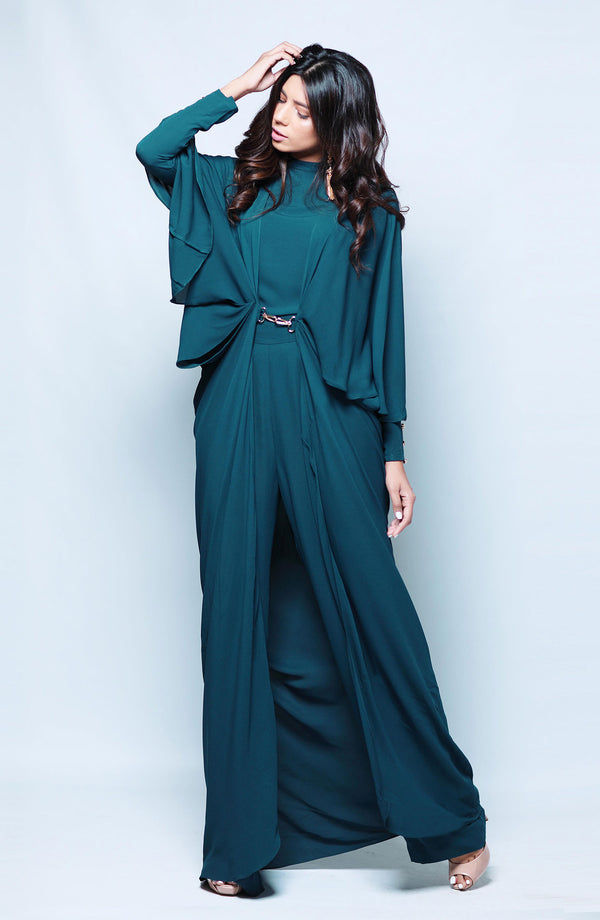 TEAL CAPE WITH METAL BUCKLE ACCENT WITH LAYERED DRAPE AND SHORT CAMISOLE AND FLARED TROUSERS MATCHING SEPARATES