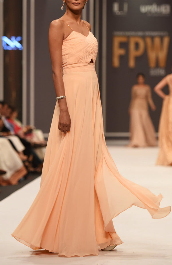 Peach draped dress.