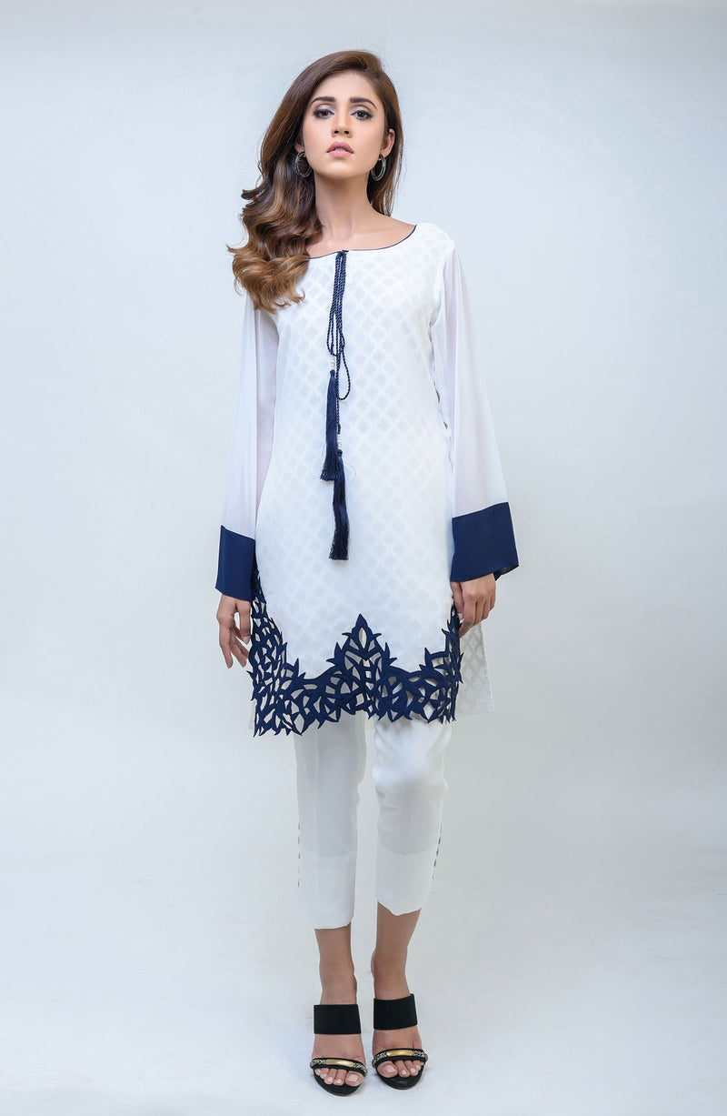 WHITE KURTA IN COTTON NET  WITH NAVY BLUE CUTWORK AND A TASSEL AND COLOUR BLOCK SLEEVES