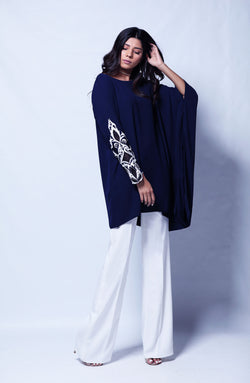 PARTYWEAR NAVY BLUE Kurta IN ANGULAR CUT  WITH WHITE HAND EMBROIDERY ON ONE SLEEVE AND WHITE PANTS