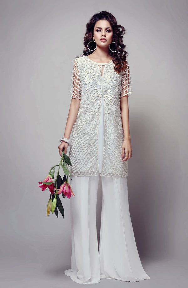 WHITE CUTWORK JACKET WITH WHITE SLIP TUNIC AND FLARED SHARARA PANTS