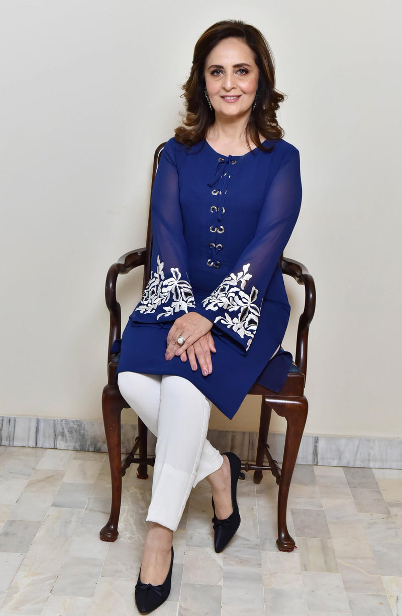 Blue Tunic-reivetted neckline.