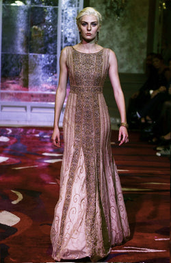 Gown In hues of gold and champagne.