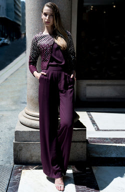 CROPPED JACKET FULLY HANDWORKED IN MIRROR WORK IN PLUM AND SILVER THREADWORK TILLA PAIRED WITH PLUM PURPLE CAMISOLE AND FLARED TROUSERS