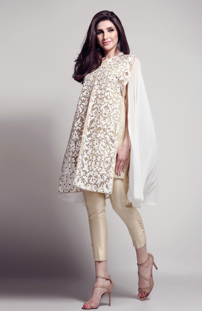 APPLIQUE CAPE IN WHITE  AND BEIGE NET WITH NUDE  SLIP AND MODERN CIGARETTE PANTS