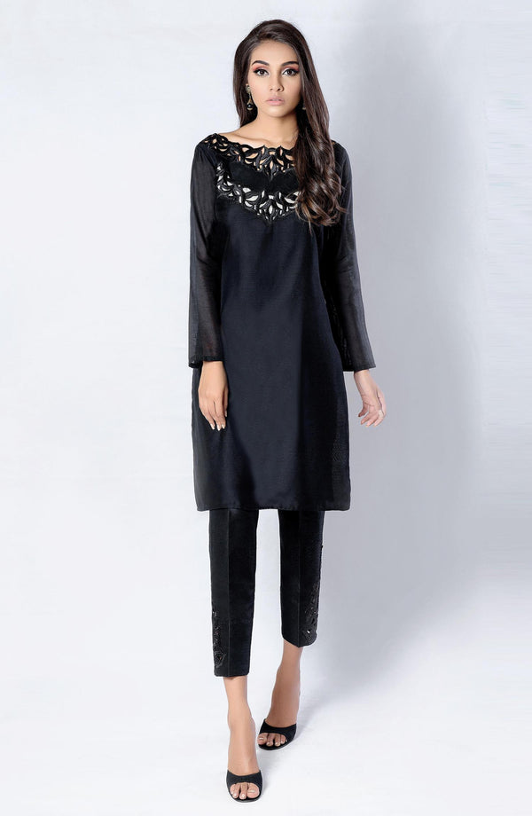 Black tunic with cutwork neckline.