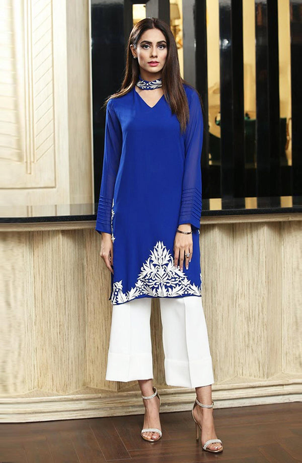 Blue tunic with embroidery.