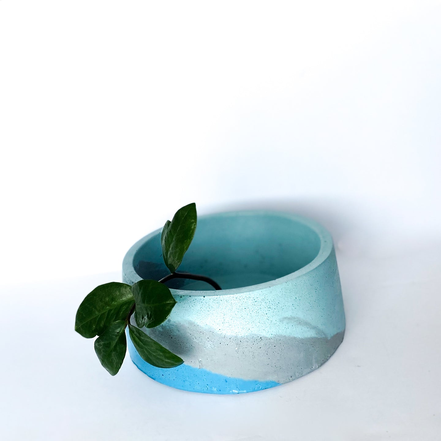 Concrete circular planter with drain hole